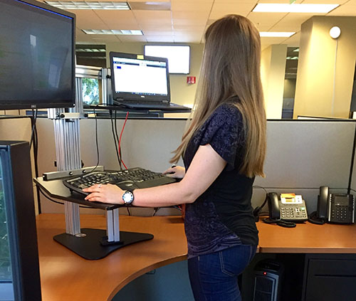 Emily working at her standing desk