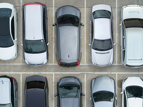 cars parked in a full lot
