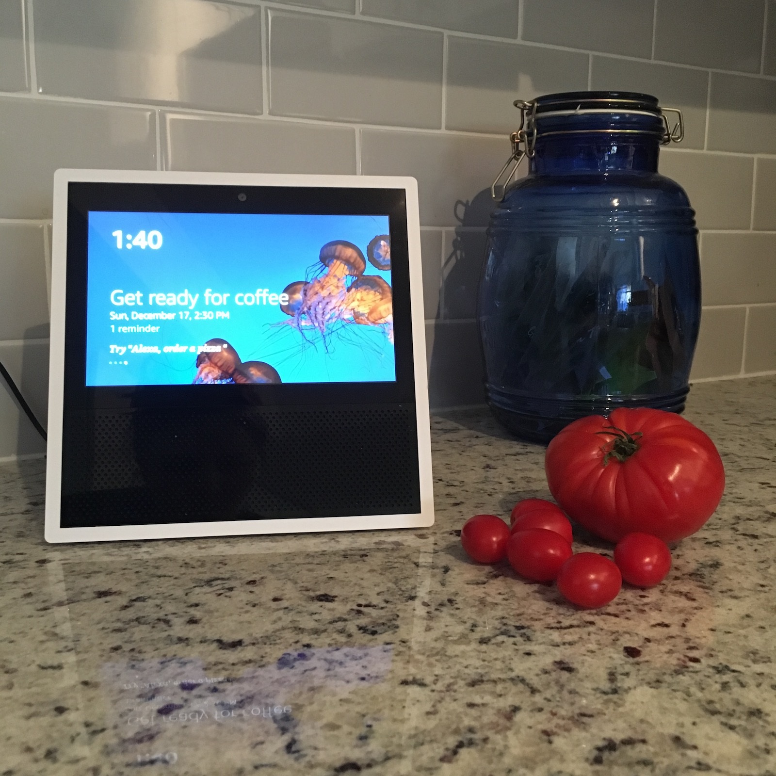 Amazon Echo Show on kitchen counter with tomatoes