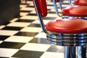 red bar stools in diner